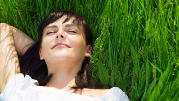 happy woman in grass formatted istock