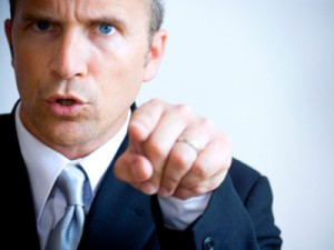man-suit-angry-pointing-istock