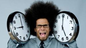 office-worker-stressed-with-9-to-5-clocks-jpg