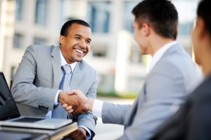 istock-business-men-shaking-hands-one-black-one-white