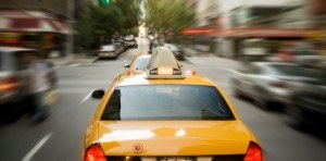 Fast moving taxis on New York streets