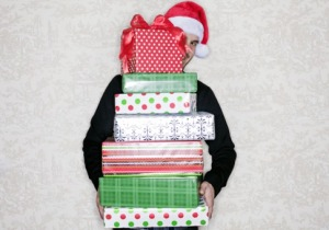 1206_holiday-overspending-intro-pile-gifts_485x340
