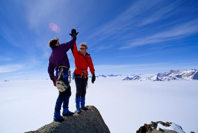 top-of-mountain-high-five-accomplishment-goal